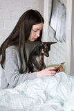 Friendship between woman and dog stock photos