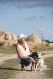 Friendship woman and pet dog outdoor Royalty Free Stock Photography