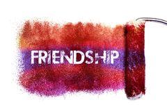 The friendship word painting. Color full on white paper by roll painter,isolated Stock Image
