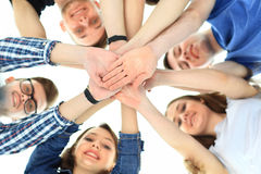 Friendship, youth and people concept - group. Of smiling teenagers with hands on top of each other royalty free stock image