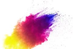 Frieren Sie Bewegung von den farbigen Pulverexplosionen ein, die auf weißem Hintergrund lokalisiert werden lizenzfreie stockbilder