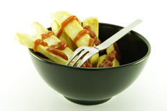 Fries in a Black Bowl Stock Images