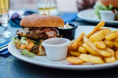 Fries and Burger on Plate Stock Images