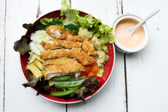 Fries chicken salad. With cream in red bowl Stock Image