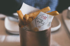 Fries in cup on table