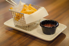 Fries. French fries served in stainless steel dipping tray on a square plate stock photography