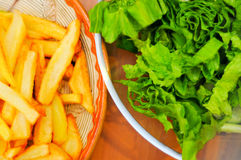Fries and green salad Royalty Free Stock Photo