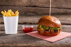 Fries with ketchup and burger. Stock Photos