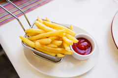 Fries and ketchup on the table. French fries with ketchup on the table Royalty Free Stock Photos