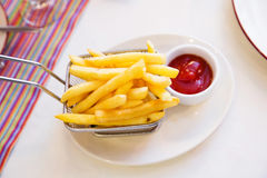 Fries and ketchup on the table. French fries with ketchup on the table Stock Photos