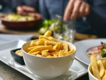 Fries with mayonaise in restaurant Stock Photography