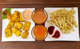 Fries, Pakora and Juice stock photography
