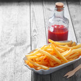 Fries on Plate and Sauce in Glass Jar on the Table Royalty Free Stock Images