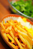 Fries and salad Stock Image