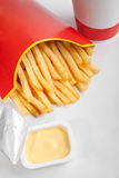 Fries with sauce and a beverage Royalty Free Stock Images