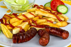 Fries with sausages Stock Images