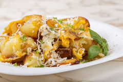 Fries with smashed eggs and parmesan with herbs on plate Stock Photo