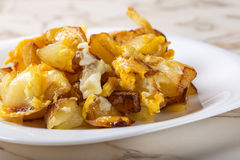 Fries with smashed eggs on white plate Royalty Free Stock Photography