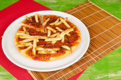 Fries toppin pizza Royalty Free Stock Images