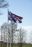 The friesland and dutch flag together Stock Photos