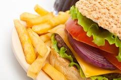 Frieten, Grote Cheeseburger en Kola royalty-vrije stock afbeelding