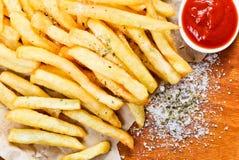 Frieten met ketchup Stock Foto