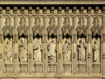 Frieze of martyrs Westminster Abbey. Frieze of martyrs above the west door of Westminster Abbey in London Royalty Free Stock Photos