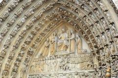 Frieze and the tympanum of the portal of the Last Judgement at Notre Dame de Paris. The tympanum of the portal of the Last Judgement at Notre Dame de Paris is an Royalty Free Stock Images
