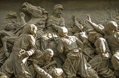 Frieze from Victor Emmanuel II Monument, Venice. Bronze frieze showing a battle in the unification of Italy.  Plinth of the Victor Emmanuel II Monument in Venice Stock Photography