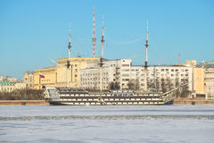 Frigate `Blagodat` in the background of the Petrovskaya embankment, sunny January day. Saint Petersburg Stock Photography