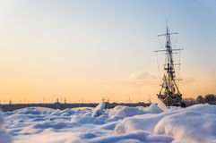 Frigate bound by ice. Extreme cold. The concept of global cooling. Frozen ship in the ice on the river Neva. Saint-Petersburg. Stock Photography