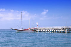 Frigate moored to a pier Royalty Free Stock Photo