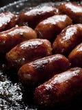 Friggere salsiccia fotografie stock libere da diritti