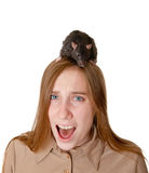 Fright. The scared girl with a rat on a head Royalty Free Stock Images