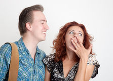 In fright. The cheerful men and the scared girl Stock Images