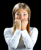 Fright. The blonde covering mouth by hands. looking at camera Royalty Free Stock Photos