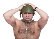 Fright. A series of photos of the person in an army helmet Stock Photography