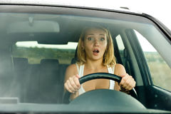 Fright face of woman in car stock image