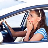 Fright face of woman in the car. She is scared and shocked by driving car royalty free stock photography