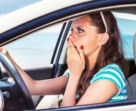 Fright face of woman in the car. She is scared and shocked by driving car stock images