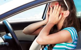 Fright face of woman in the car. She is scared and shocked by driving car stock photos