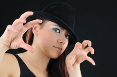 Fright girl. In black hat stock photo