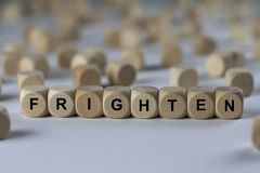 Frighten - cube with letters, sign with wooden cubes Royalty Free Stock Photos