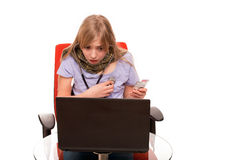 Frighten hypochonder. Hypochondria - Young Female checking herself with a stethoscope and searching information about her disease on a laptop royalty free stock photo
