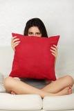 Frighten woman. On sofa, on a white background royalty free stock photo