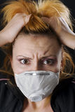 Frighten woman wearing face mask Stock Photos