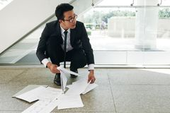 Collecting fallen documents Stock Images