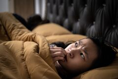 Free Frightened Asian Child Girl Is Looking Around And Nail Biting,stress,worry,feels Scared,anxiety,hearing Something Haunting, Stock Image - 192244471