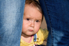 The frightened babe-4. Little frightened girl looking seriously Stock Image