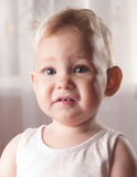 Frightened baby face Stock Images